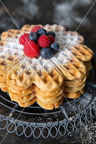 Waffles with berries and powdered sugar