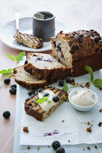 Banana bread with blueberries and white chocolate served with cinnamon and honey cream