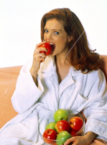 A Woman Biting into an Apple