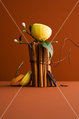 An arrangement of cinnamon sticks and chocolate