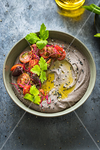 Black bean hummus with tomatoes, olives and fresh mitsuba herb