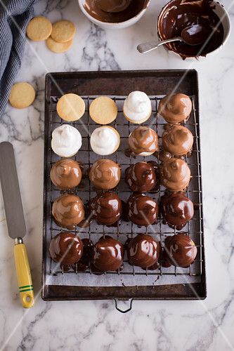 Sweetie pies with marshmallow cream and two types of chocolate glaze