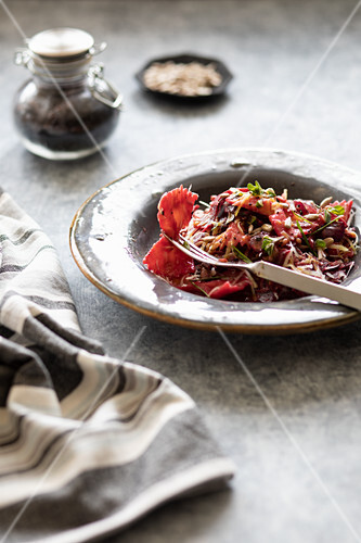 Farfalle with beetroot, herbs and sunflower seeds