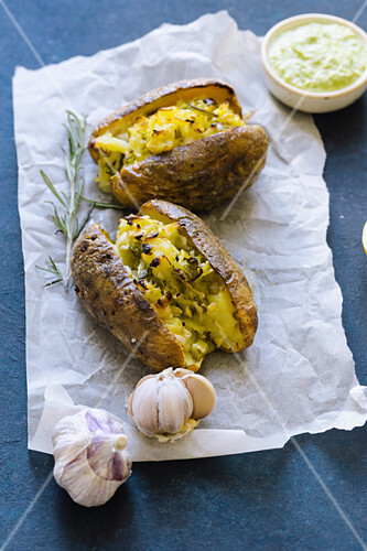 Twice baked potatoes with scallions, garlic and olive oil served with green pesto sauce