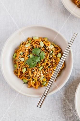A bowl of sweet potato noodle pad thai