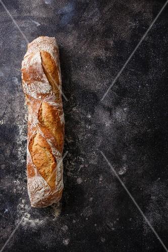 Fresh Baguette bread on dark background copy space