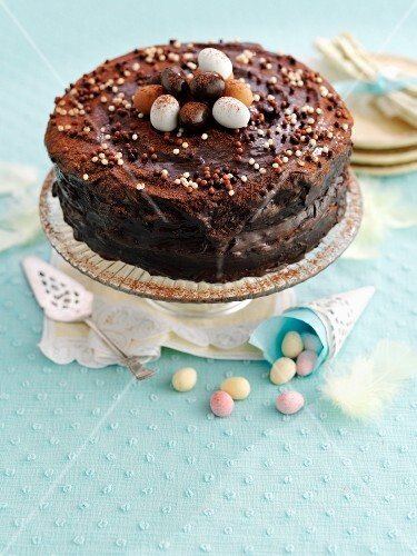 Chocolate cake with sugar beads and chocolate eggs (Easter)