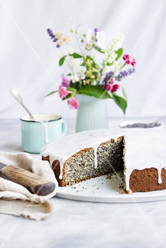 Piegusek (poppy seed cake, Poland) with a sugar glaze, sliced