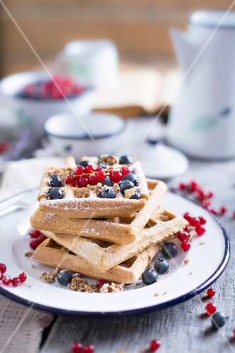 Gluten Free Waffles With Blueberries and Redcurrant on an old wooden table
