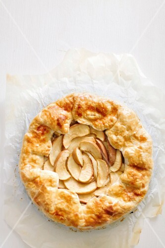 Galette with apples and cinnamon on parchment paper