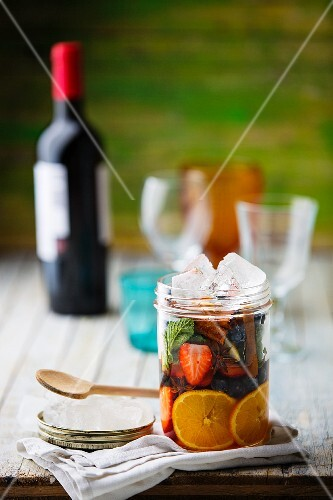 Ingredients for sangria in a glass jar