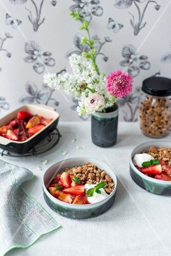 Strawberry and peach compote with almond granola, coconut milk yoghurt and mint