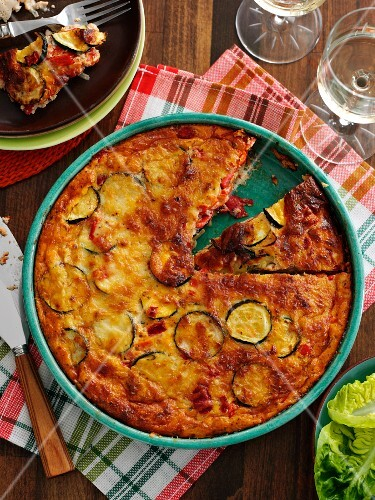 Crustless zucchini quiche with onions and cheddar