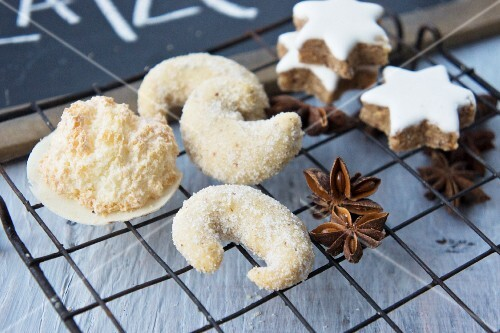 Wafer biscuits with a coconut crust, a vanilla dip, cinnamon star and star anise