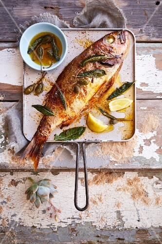Whole baked fish with lemon and caperberry butter