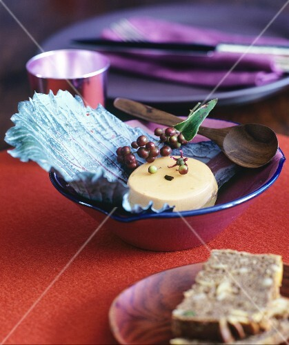 Goose liver pate on red cabbage leaves