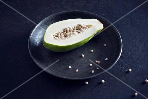 A green papaya on a plate