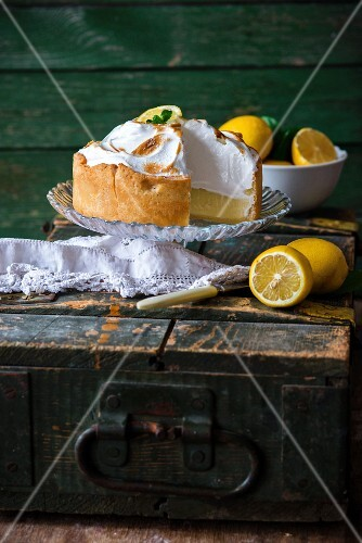 A lemon meringue pie with a slice cut out