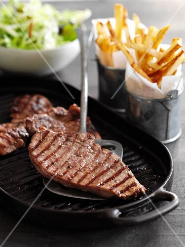 Minute steaks with fries and salad