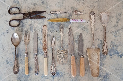 Various pieces of antique cutlery, cake servers and scissors