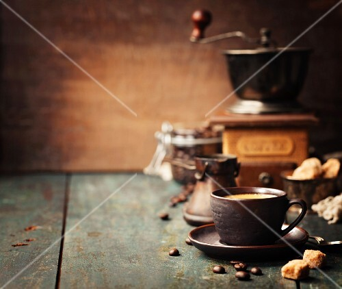 Coffee composition (cup of coffee, coffee beans, sugar and Vintage Grinder)