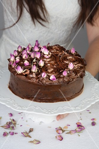 Chocolate mud cake decorated with dried rosebuds