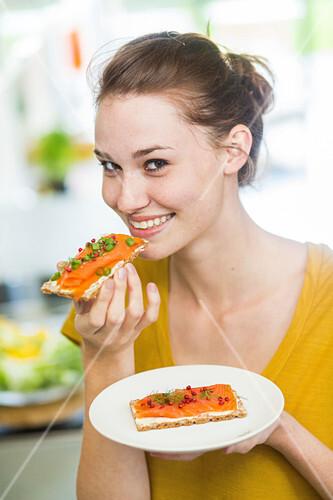 Woman eating salmon