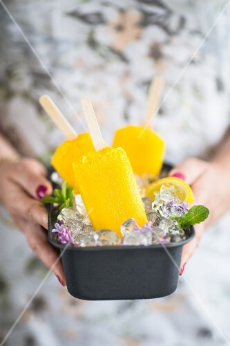 Mango lemon ice popsicles
