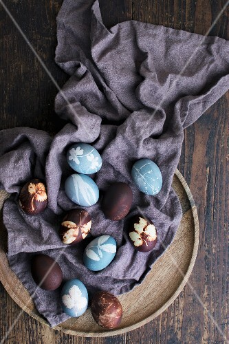Blue and brown Easter eggs on a cloth