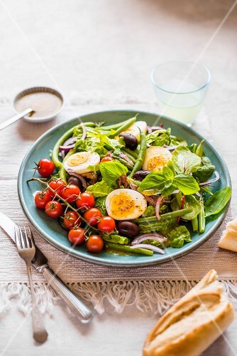 Nicoise salad with beans, eggs, anchovies, olives and tomatoes