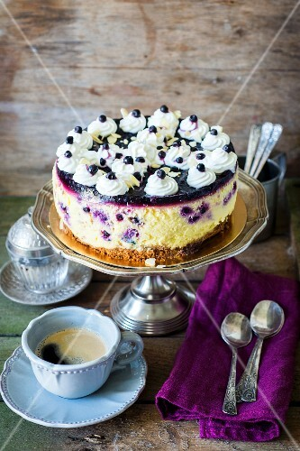 Cheesecake topped with blueberries and cream