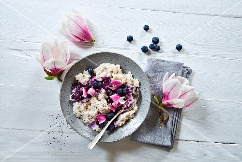 Rice pudding with blueberries and magnolia blossoms