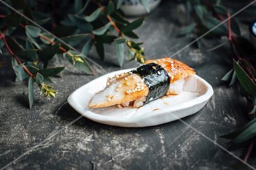 Nigiri sushi with eel and sesame