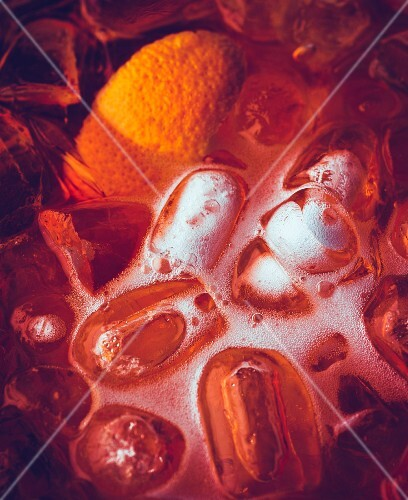 An aperitif with ice cubes and orange