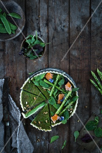 A wild garlic and asparagus tart with salmon (top view)