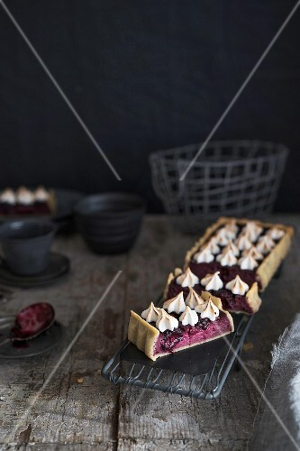 Blackberry tart with cottage cheese, on a rustic wooden table