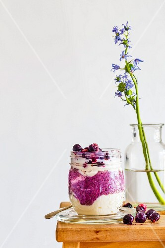 Breakfast in a glass with blueberry and chia pudding and yoghurt