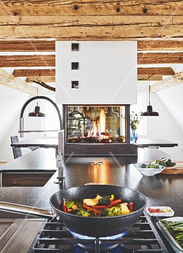 A Kitchen Island With A Gas Oven And Granite Worktop With A