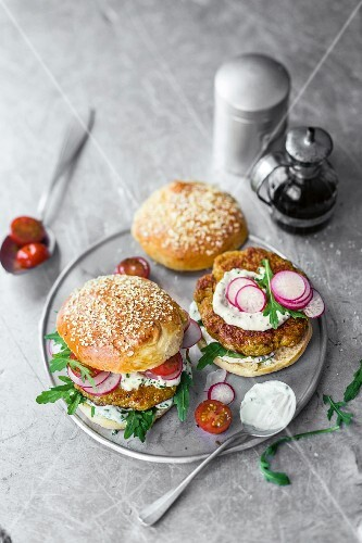 Burgers with seitan and millet patties, radishes, and a chive dip