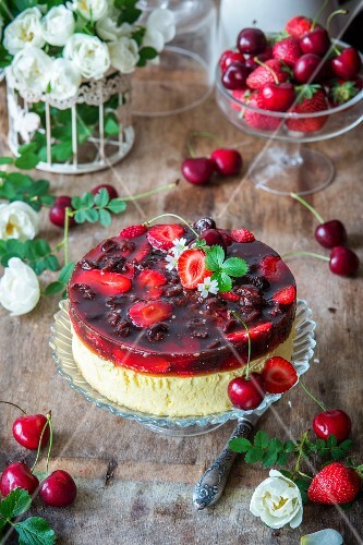 A summery cheesecake topped with berry and cherry jelly