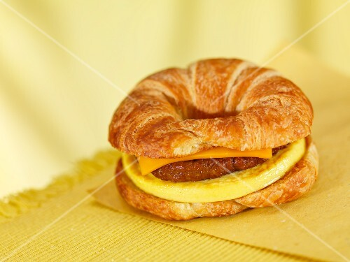 A croissant 'burger 'with cheese and omelette
