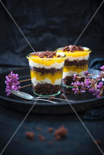 Vegan desserts made with chocolate cake, vanilla semolina cream, and mango purée