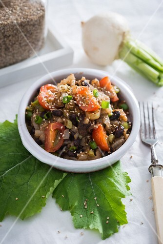 A warm salad with turnip and black beans (vegan)