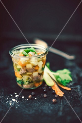 Boiled beef soup in a glass