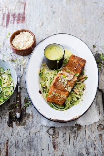 A salmon fillet on courgette noodles with coconut and coriander cream