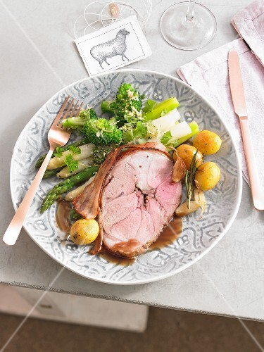 A portion of lamb with asparagus, broccoli and potatoes for Easter