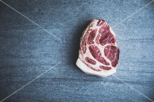 Raw free-range, organic pork steak (seen from above)