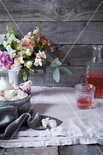 Meringues and flowers on a table
