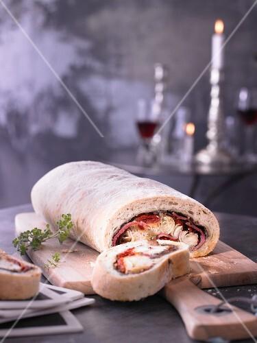 Ciabatta stuffed with pastrami, artichokes and scarmorza cheese