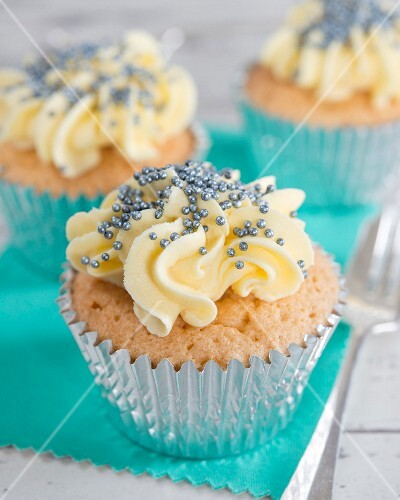 Cupcakes with buttercream and blue sugar pearls